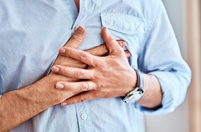 What are heart palpitations and their causes?